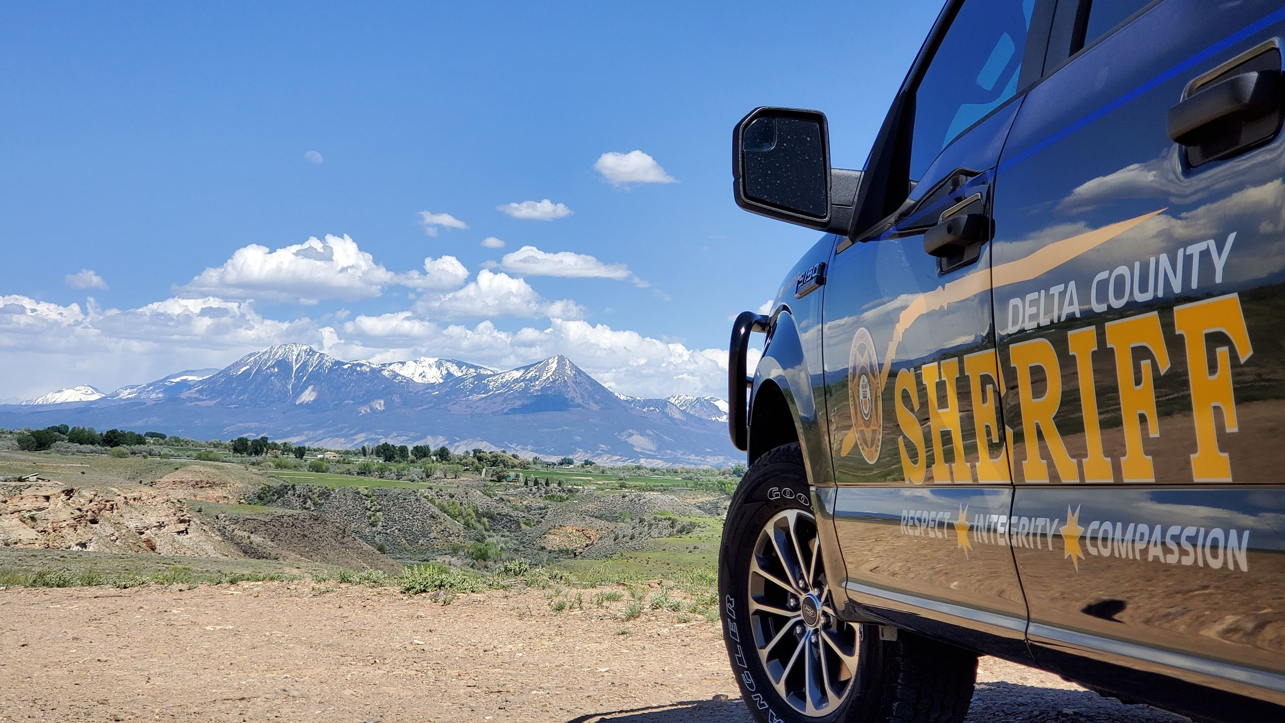 Reflection of Mt. Lamborn on Sheriff Patrol Pickup Photo